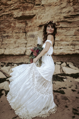 The light and airy hippie boho wedding dress by Gwendoline is the perfect wedding outfit for a beach wedding