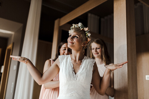 happy and relaxed mood while putting on wedding dress