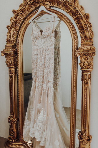 a golden mirror is a perfect place for your wedding gown.