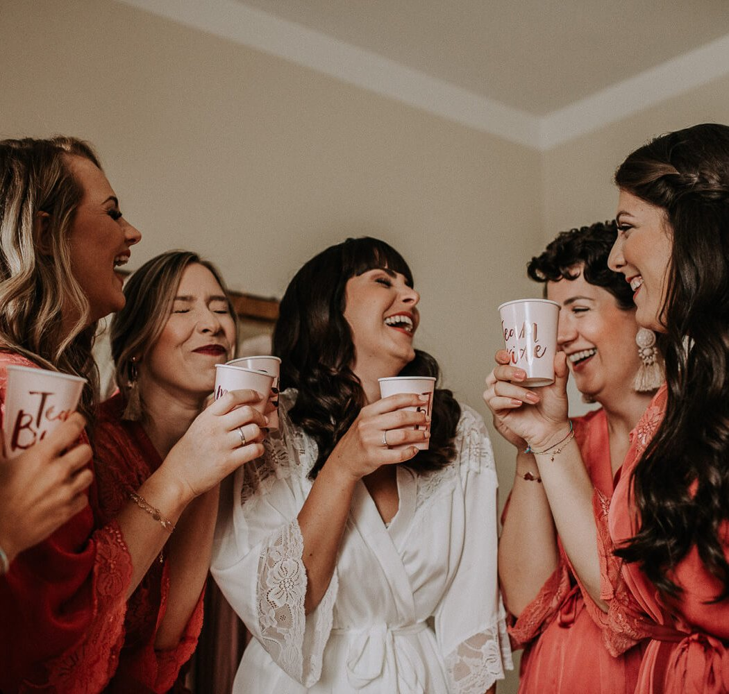 a wonderful happy and emotional moment of the bride with her bridesmaids