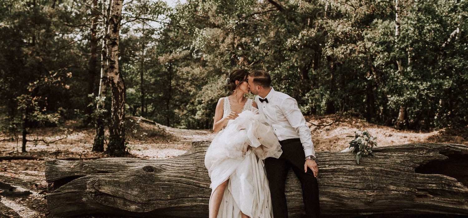 What a beautiful scenery. He kisses slightly her lips, while leaning against a tree trunk. So romantic!